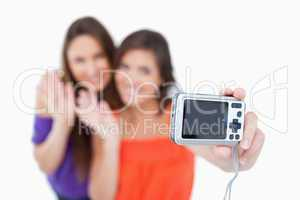 Digital camera taking a picture of two teenagers