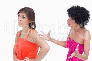 Upset teenager roaring at a friend against a white background