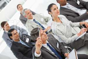 Man asks question at business meeting