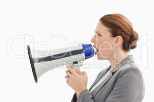 Businesswoman talking into megaphone