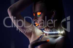 Beauty woman dance with glow make-up