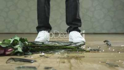 Man dropping vase of flowers