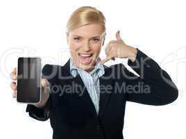 Saleswoman displaying new iphone to camera