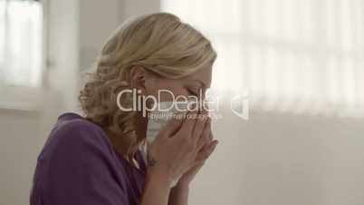 Allergy and health problems for young woman sneezing at work