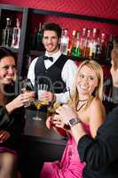 Barman prepare cocktails friends drinking at bar