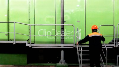 Worker Climbs Stairs And Goes By Platform