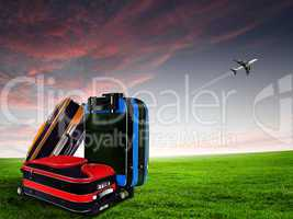 Red suitcase and plane