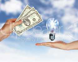 Human hands with money and electric bulb