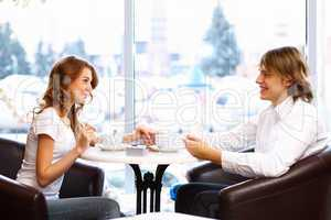Young couple having a date in restaurant