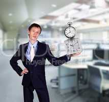 businessman in office holding clock pyramid