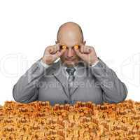 Bald young businessman with a small coin