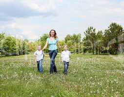 mother with her two sons outdoors