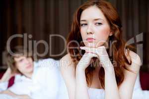 couple in disagreement in bedroom