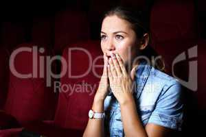 Young girl in cinema