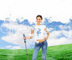 Young woman with paint brush and natural landscape