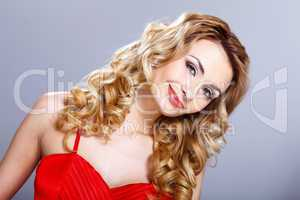 Young woman in red dress with curly hair