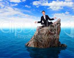 Businessman in suit praying for success