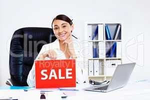 Young woman in business wear with sale sign