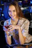 Attractive woman in night club with a drink
