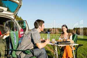 Camping car young couple enjoy picnic countryside