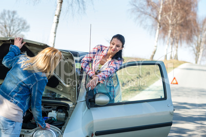Starting broken car two women have problems