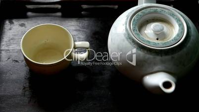 Teapot pouring tea,ancient customs of leisure.china,japan,water.