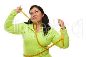 Frustrated Hispanic Woman Tied Up With Tape Measure