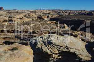 Rocks and wide view with Manti La Sal Mountains near Secret Spire, Utah