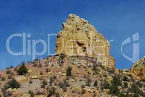 Rock wall and boulders near Wolverine Petrified Wood Area, Utah