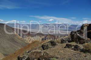 Black rocks, valleys and snow mountains near Death Valley, California