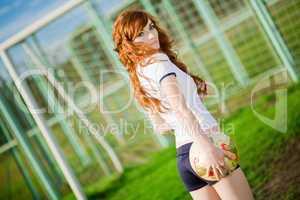 Beautiful redhead girl plays soccer