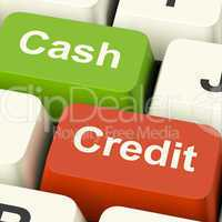 Cash And Credit Keys Showing Consumer Purchases Using Money Or D