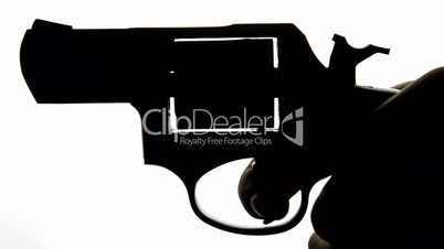 Silhouette Of Hand With Gun