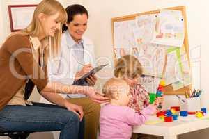 Pediatrician female observe children play activity