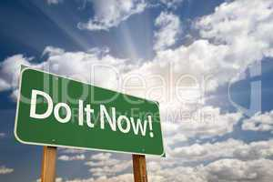 Do It Now! Green Road Sign and Clouds