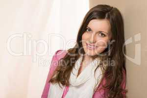 Smiling brunette woman in pink top