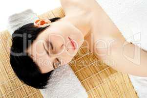 Closeup of a gorgeous girl relaxing at spa