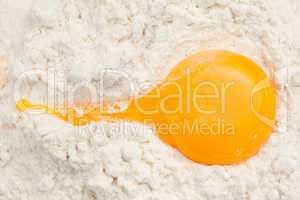 Egg yolk on the flour