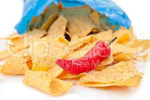 Open bag of crisps with a red pimento