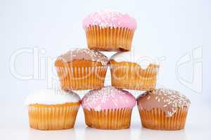 Pyramid of muffins with icing sugar