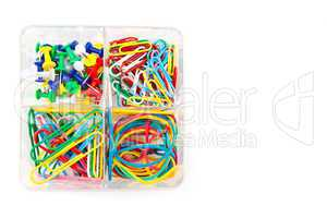Box with multicolored of pushpins and paperclips