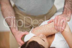 Osteopath making a joint mobilisation
