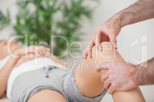 Practitioner using his fingers to massage a knee