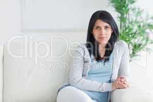 Woman sitting on the end of a couch