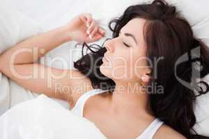 Brown-haired woman sleeping in the morning