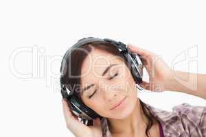 Woman enjoying music with headphone