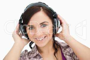Blue eyed woman wearing headphones