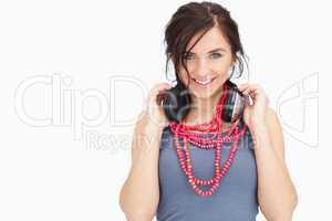 Blue eyed student holding her headphones