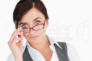 Blue eyed businesswoman holding her glasses