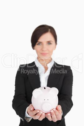 Businesswoman holding a piggy-bank
